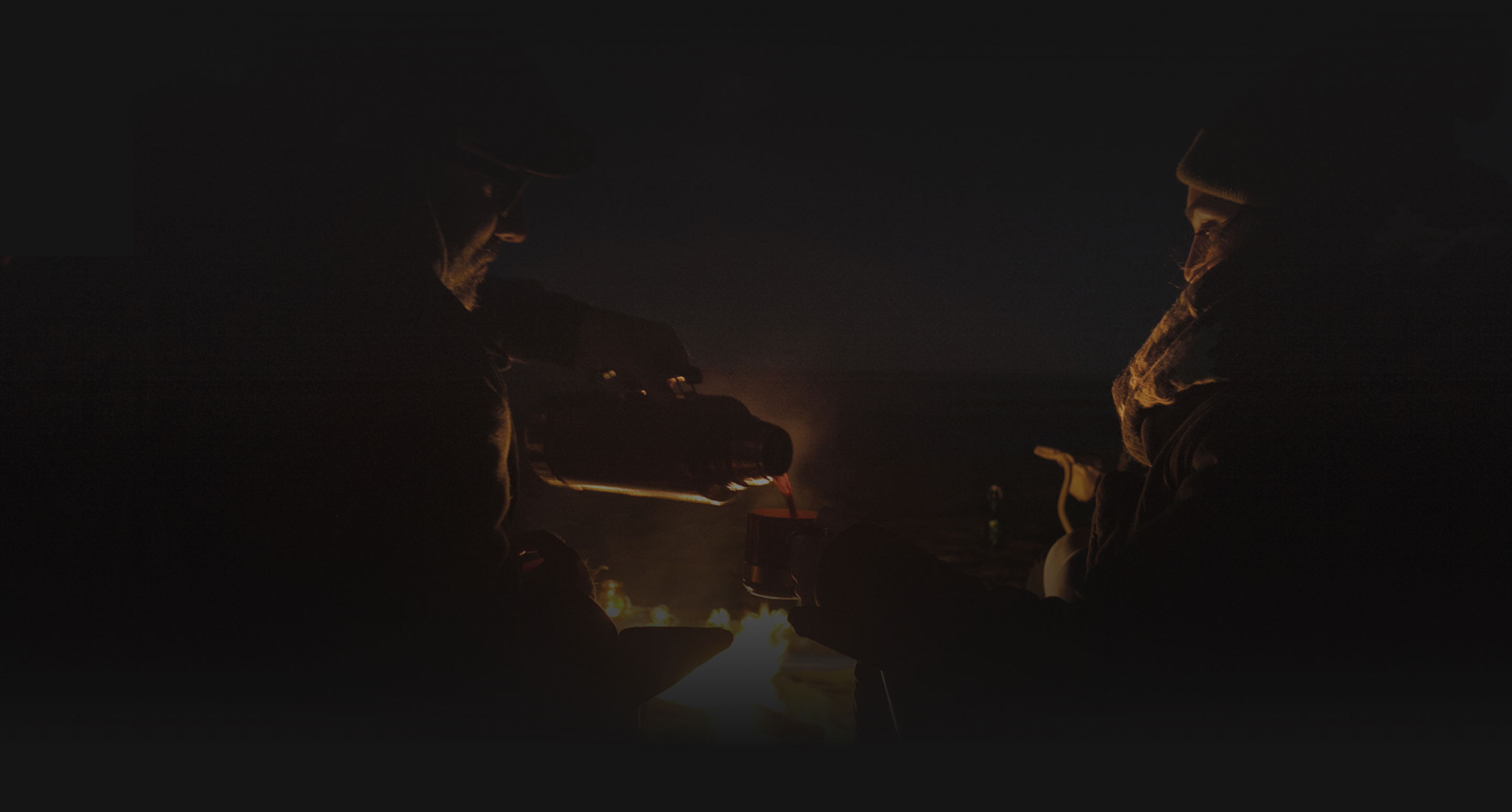 Gathered Around a Campfire Singing a Campfire Song