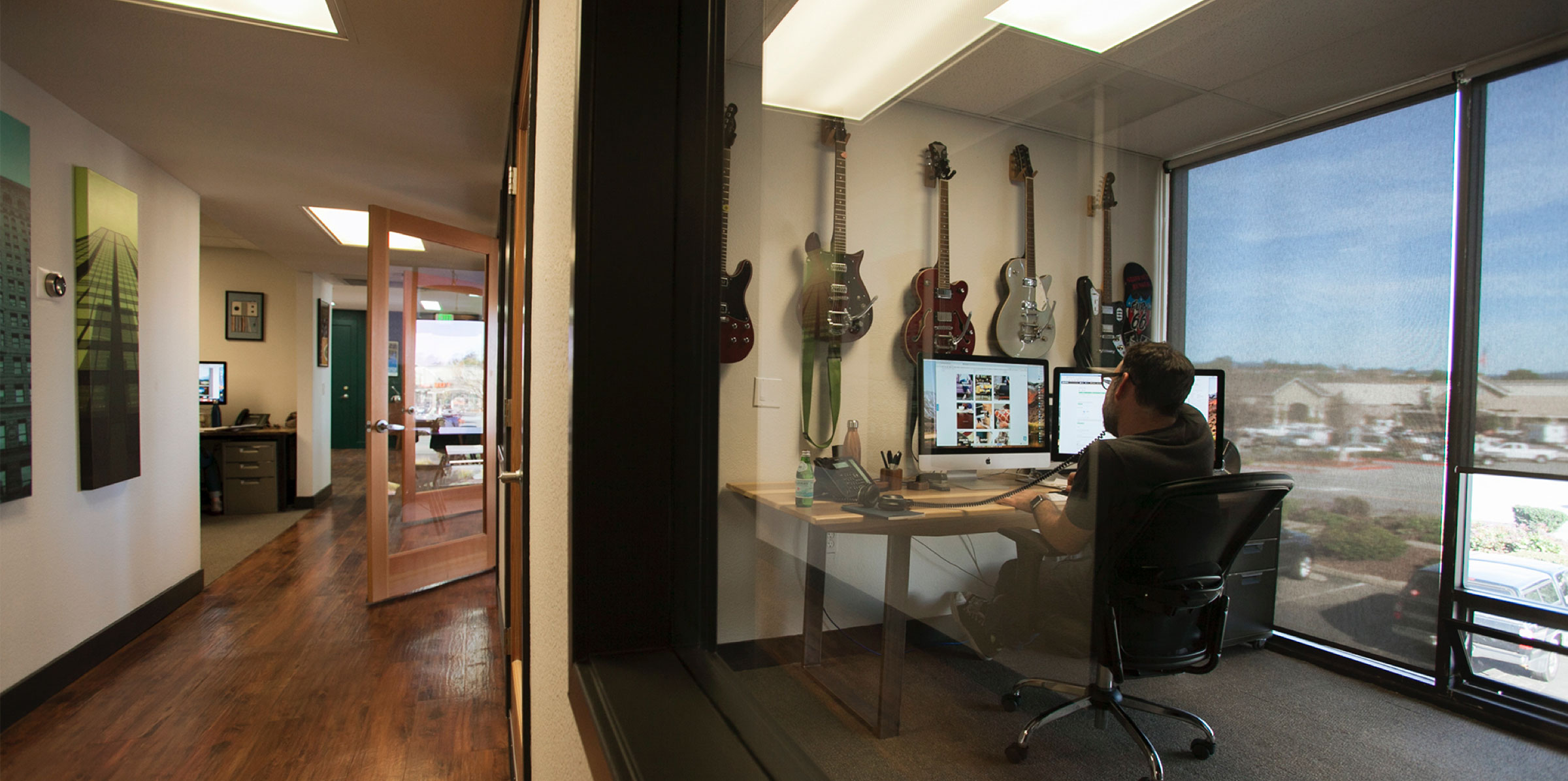 jon in his office full of guitars
